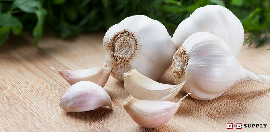 Harvesting and Curing Garlic - Garlic cloves on a table